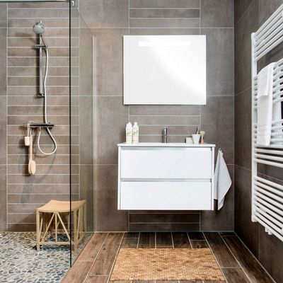 Plato de ducha de obra con cantos rodados