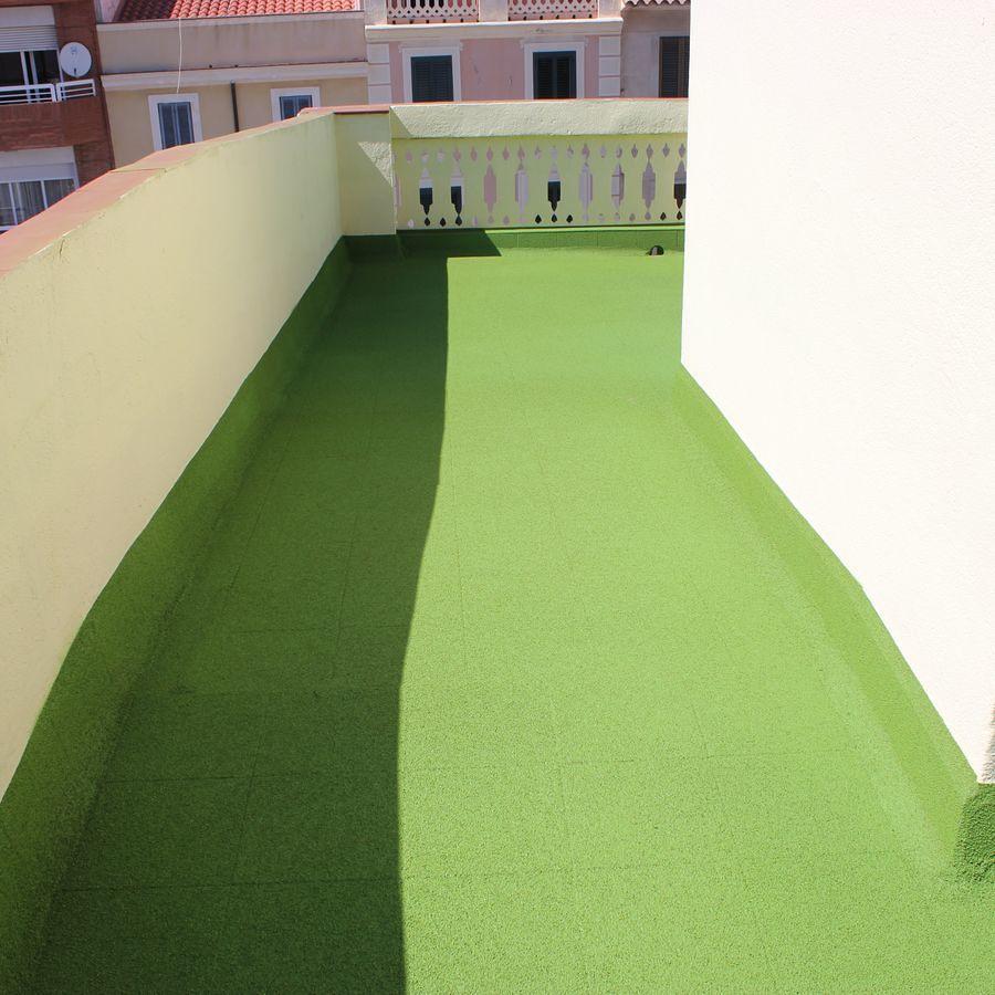Pintar las paredes y muros de la azotea
