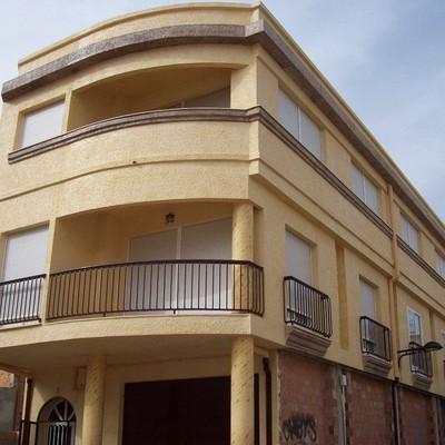 Rehabilitación de fachada con enfoscado de cemento