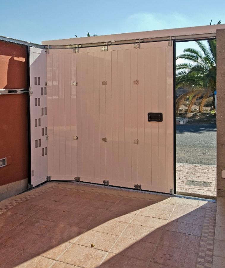 Presupuestos y precios para reparar puertas de garaje for Puertas de garaje precios