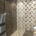 Mampara de baño esquinera con fijo y corredera