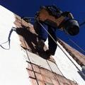 Aplicación de mortero de revoco en fachada