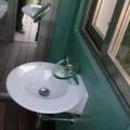 Baño microcemento verde musgo