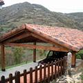 Cenador de madera y cubierta de teja cerámica mixta