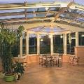 Cerramiento de restaurante en hotel a 3 aguas con 2 techos motorizados en vidrio  + 1 techo fijo
