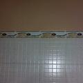 colocación de azulejo a media altura
