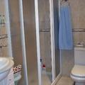 Construcción de baño y coclocación de mampara