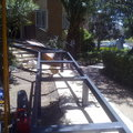 Construccion rampa minusvalidos y modificacion de escalones.