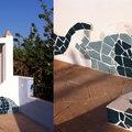 Diseño y ejecución de pérgola con motivos marinos y técnica de mosaico.
