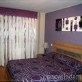 Dormitorio actual en lilas