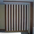 Elaboración de rallas en pared de salón.