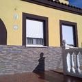 fachada pintada y socalo colocado