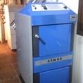 Instalación de caldera ATMOS DC25S de gasificación de leña.