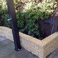 Jardinera y ducha solar