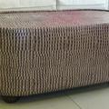 Mesa de centro obalada tapizada