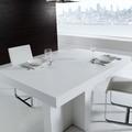 Mesa de comedor pie central en laca blanca.