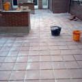 patio de 120m2 realizado con impermeabilizacion de resinas de caucho y fibra de vidrio, solera de cemento y suelo rústico