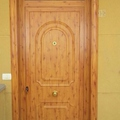 puerta de entrada aluminio roble