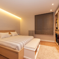 Dormitorio con armarios vestidores sin puertas | Sincro
