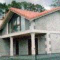 Vivienda de bloques revestidos con mortero de cemento