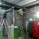 Caldera de biomasa en nave de oficinas
