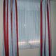 Estor veneciano y cortina en caida.