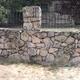 Muro de cerramiento de piedra natural