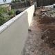 Construcción de un muro medianero