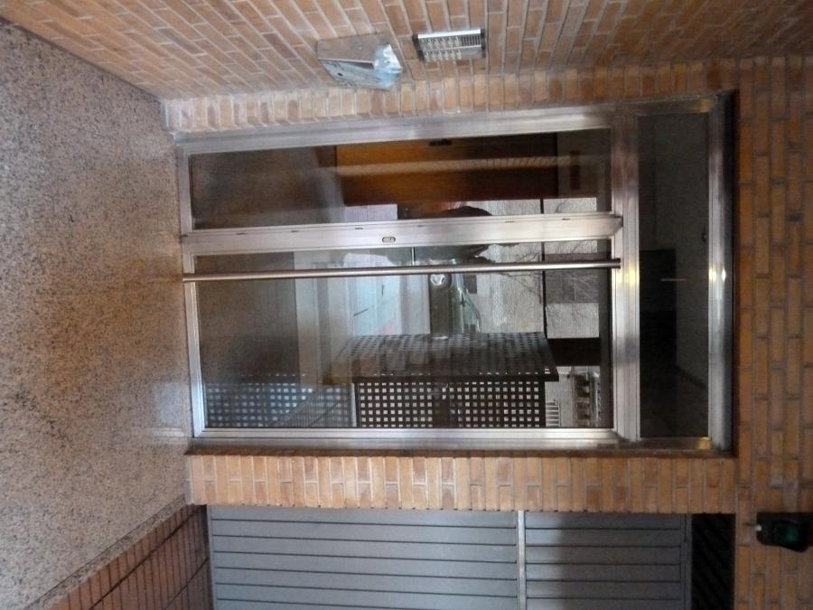 14- Puerta acceso portal acero inoxidable