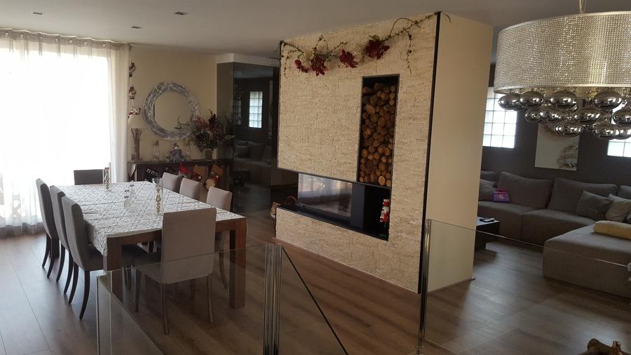 Reforma de casa y chimenea central