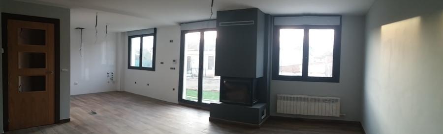 Obra nueva: Salón con chimenea