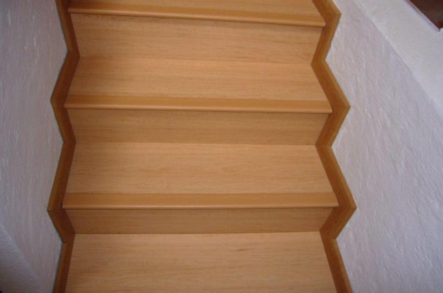 laminado roble.sobre escalera