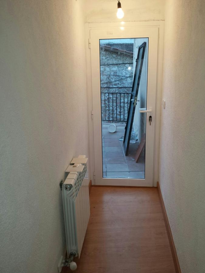 Foto aluminio puerta de terraza calefacci n y parquet de for Puertas y parquet