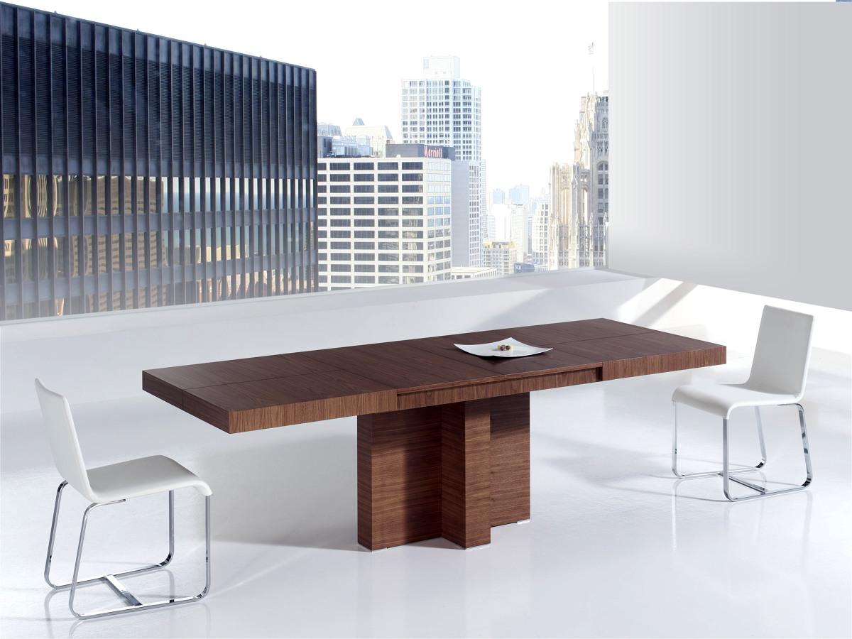 Ambiente de comedor con mesa extensible y pie central.