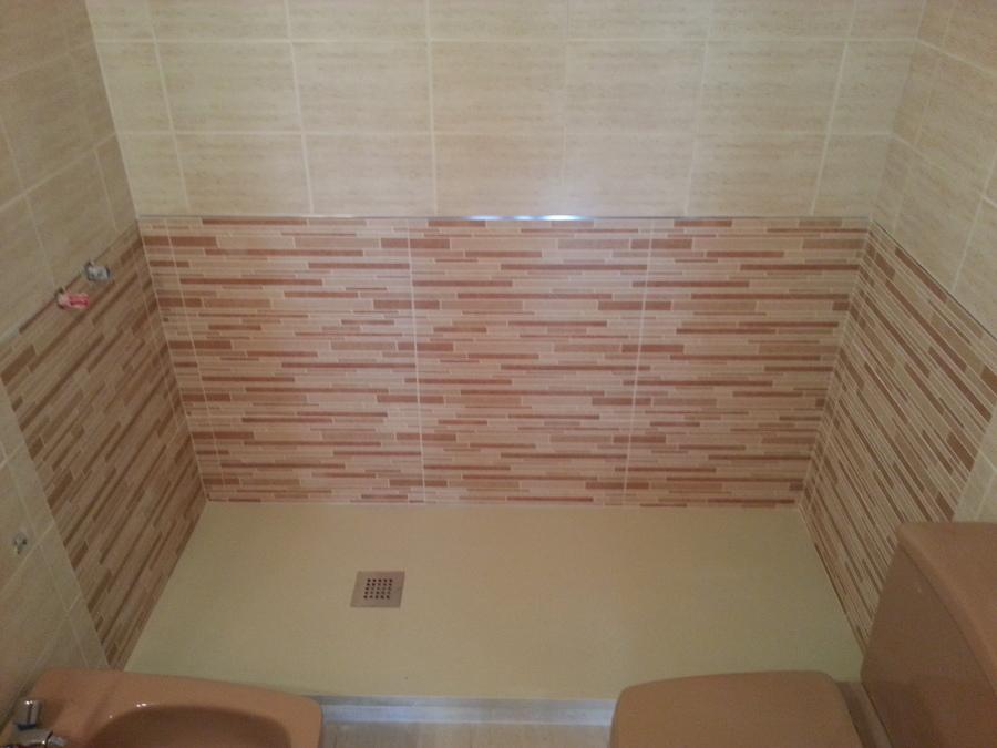 Plato de ducha de carga mineral de 1,80 con remate de azulejo no