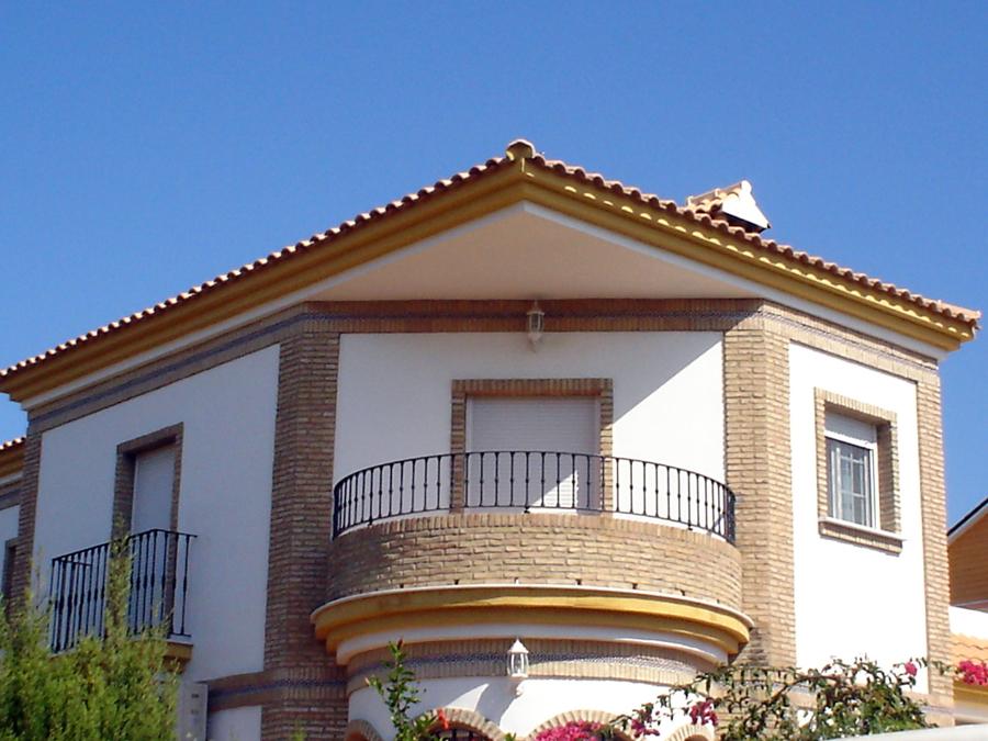 Foto casa ructica de esquina de construcciones y reformas for Casas modernas granada