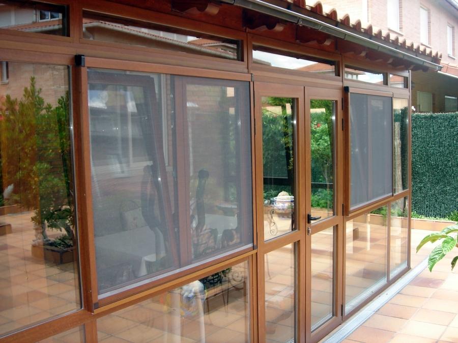Foto cerramiento exterior de carpinter a met lica aguerri for Ventanales de aluminio imitacion madera