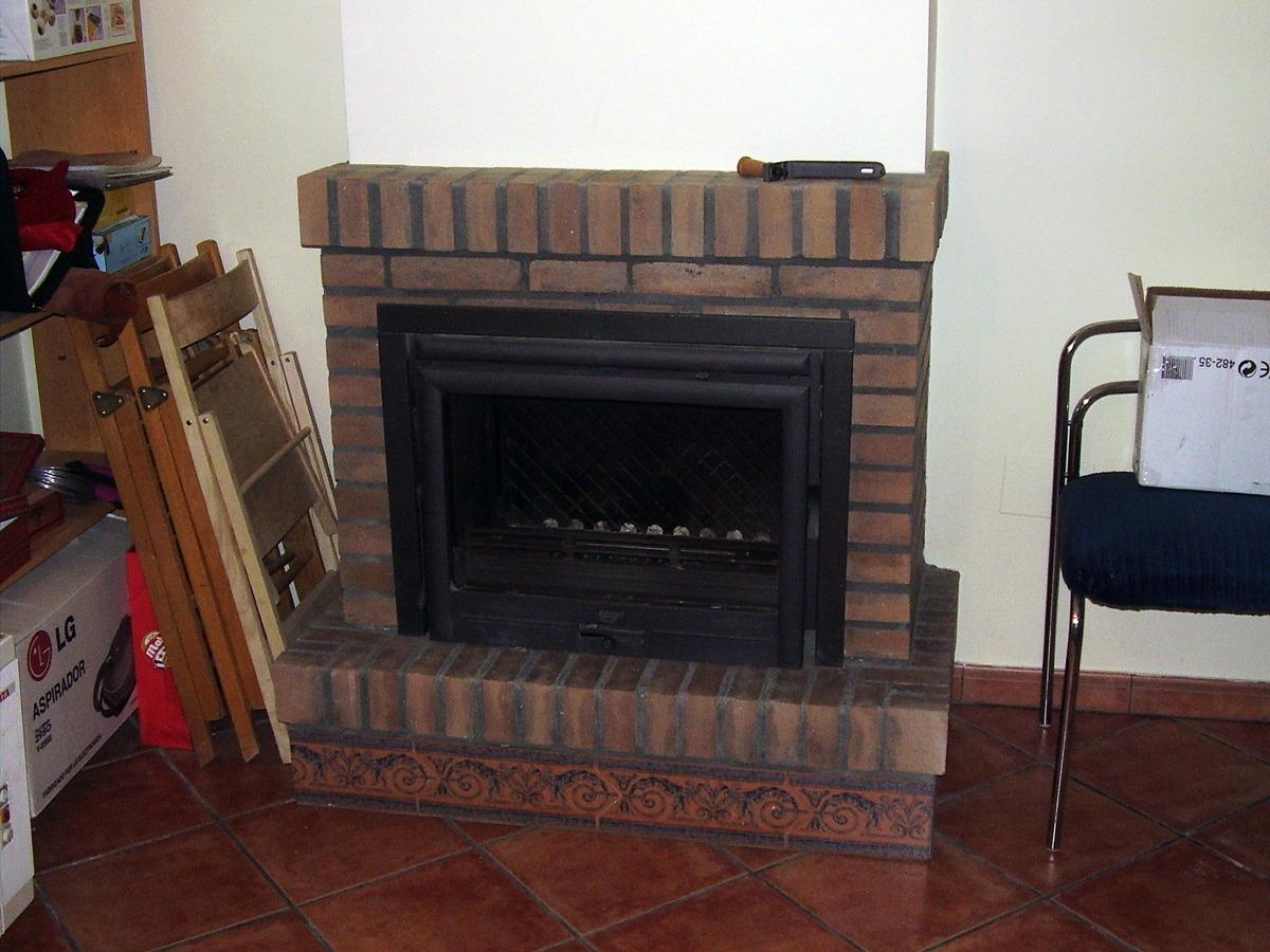 foto chimeneas de caset forradas de ladrillo visto de