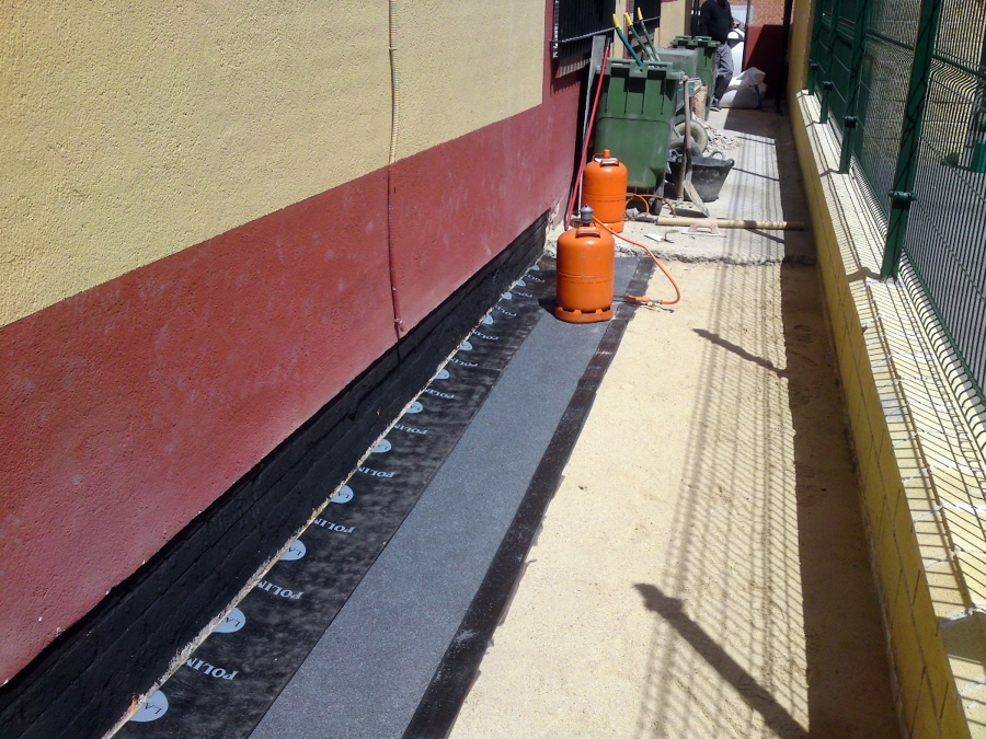 foto colocacion de tela asfaltica de pavimentos dym