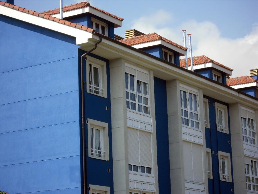 Foto fachada azul y imitacion a piedra de pintura y for Pintura color azul piedra
