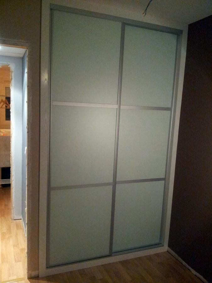 Frente de puertas corredera con vidrios