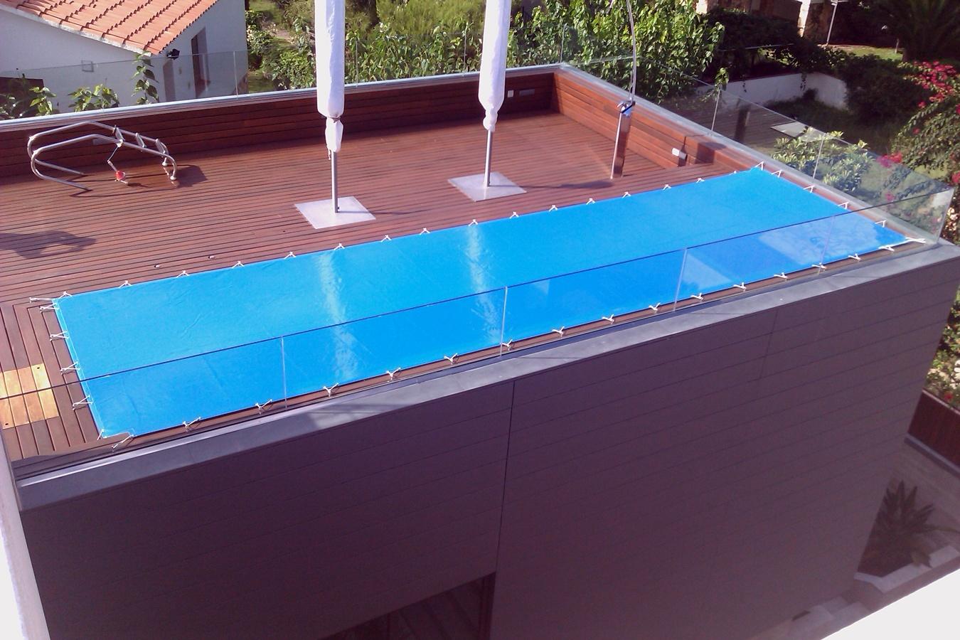 Foto lona para cubrir piscina de tapizados y fundas jb for Lonas para tapar piscinas