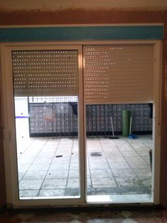 instalación de puerta de aluminio