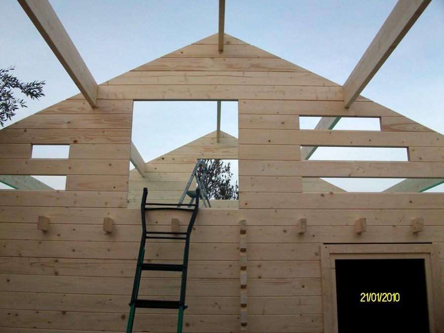Foto montaje casa de madera asva de casas de madera shop for Montaje tejados de madera