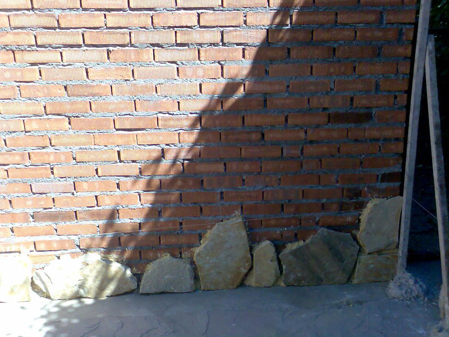 Foto muro de ladrillo chapado de piedra natural de - Muro de piedra natural ...