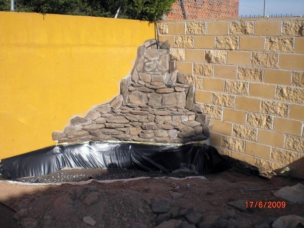 Foto obra fuente de agua con cascada de jardineria for Fuente cascada agua