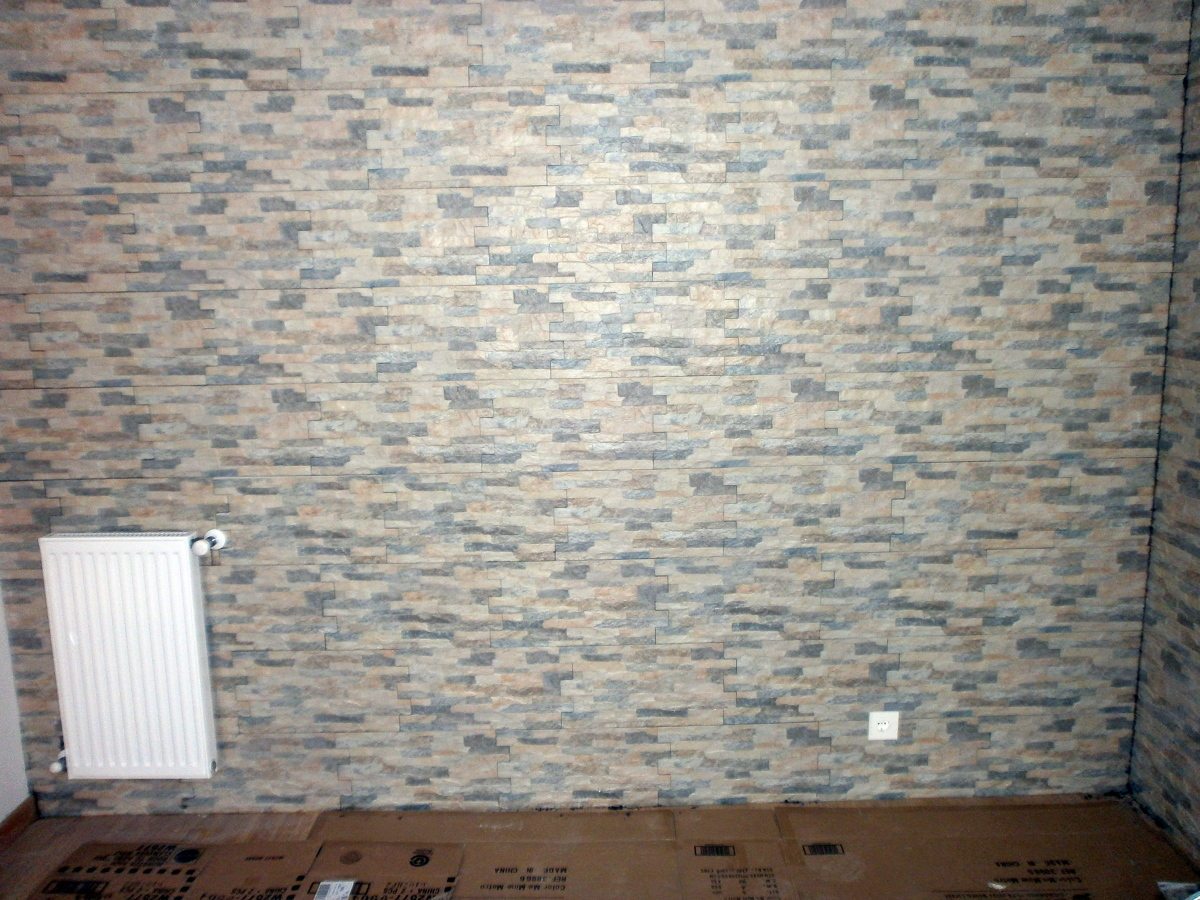 Foto pared de salon imitacion piedra de mmh reformas y - Imitacion piedra pared ...