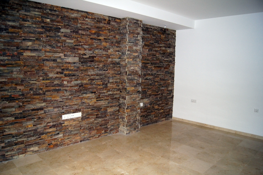 Foto pared revestida de piedra artificial de decoreformas - Piedra decorativa pared ...