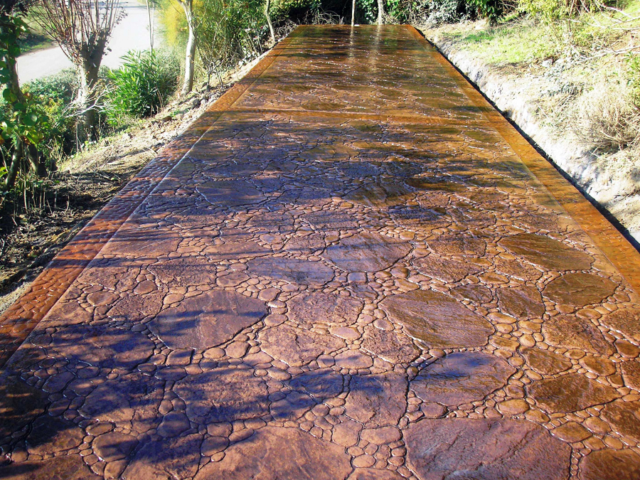 Foto piedra de rio de riv pavimentos 301380 habitissimo for Suelo hormigon fratasado