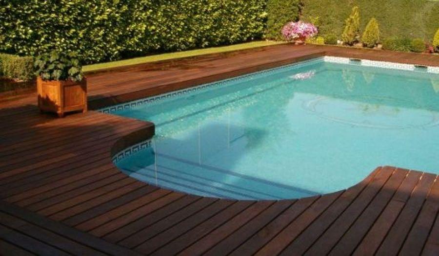 Foto piscina de obra y exterior madera tratada de pinar for Piscina valladolid